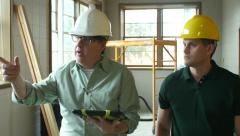 Architect and Contractor touring building - stock footage
