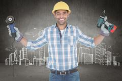 Composite image of manual worker holding power tools - stock photo