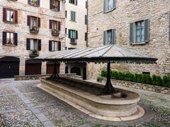 Public medieval laudry in Bergamo square Stock Photos