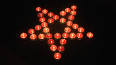 Candles arranged into pentagram symbol Stock Footage