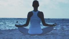 Woman in lotus pose Stock Footage