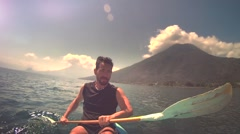 Man kayaking on lake Stock Footage