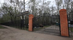 Stock Video Footage of The main entrance of the cemetry in Russia