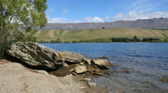 New Zealand Cromwell lakeside rocks on Lake Dunstan Stock Footage