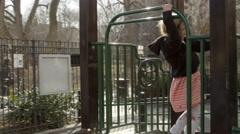 children play, boy and girl playing on playground Park in 4K NYC slow motion - stock footage
