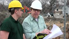 Construction worker meeting with Architect on site Stock Footage