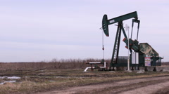 Machine pump oil jack working in agriculture field Stock Footage