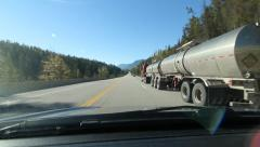 Passing double articulated tanker truck in the Rocky Mountains, BC, Canada. - stock footage
