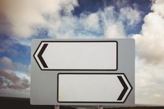 Stock Photo of Signpost arrows with copy space