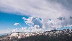 Time Lapse - Cloudscape Moving Over Mountains - stock footage