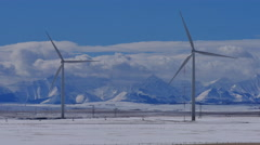 Stock Video Footage of 4k WInter Wind Turbines with Rocky Mountains 02