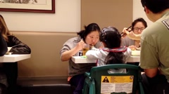 People eating food at Chinese restaurant Stock Footage