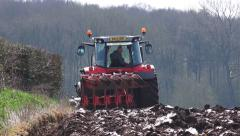 Tractor plowing field Stock Footage