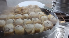 Traditional Chinese steamed buns during cooking, wrapped by corn leaves Stock Footage