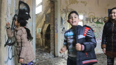 Ghetto young kids having fun in the abandone house - stock footage