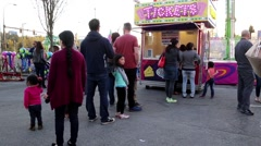 People line up for buying ticket at the West Coast Amusements Carnival Stock Footage