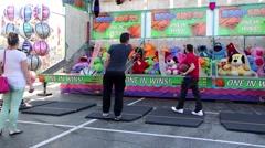 Basketball shooting game for winning animal doll - stock footage