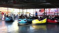 Bumper cars ride in motion at the West Coast Amusements Carnival Stock Footage