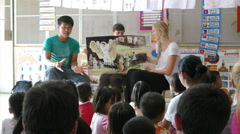 Youth Missions Team Sharing Bible Story With Hill Tribe Kids - stock footage