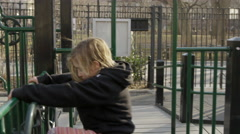 boy and girl playing on jungle gym in Washington Square Park 4K slow motion NYC - stock footage