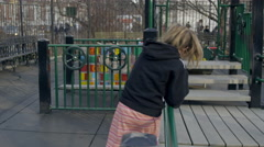 girl playing on jungle gym playground Washington Square Park 4K slow motion NYC - stock footage