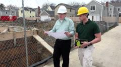 Contractors inspecting housing development - stock footage