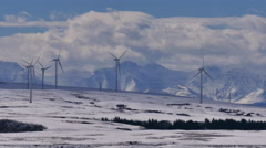 4k Winter Wind Turbines w Mountains 04 Stock Footage