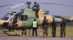 Botswana soldiers waiting for helicopter to be repaired Stock Footage
