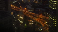 highway and buildings at night in Tokyo - stock footage