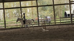 Teenage girl English style horseback riding. Stock Footage