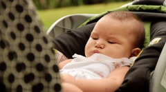 Mother Shoots Picture To Baby In Stroller With Phone - stock footage