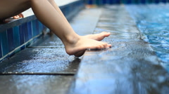 foot on the edge of swimming pool - stock footage