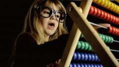 Abacus play count little girl focused Stock Footage