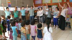 Youth Missions Team Singing Action Songs With Hill Tribe Kids Stock Footage