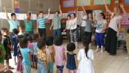 Stock Video Footage of Youth Missions Team Singing Action Songs With Hill Tribe Kids