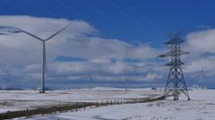 4k Winter Wind Turbines with Electricity Pylon 06 - stock footage