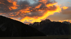 New Zealand Mt Cook gold fringed clouds over ridge time lapse Stock Footage