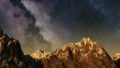 Time lapse of the sunset to night sky with stars passing by behind mountain Arkistovideo