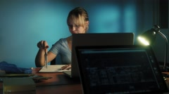 Woman With Eyes Tired Working Late At Night In Office Stock Footage