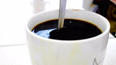 4k Ultra HD time lapse video on stirring a cup of Kopi O (black coffee) Stock Footage
