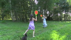 Happy pregnant mother with daughter play badminton game Stock Footage