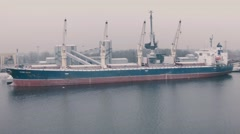A freighter is loaded with grain at a grain terminal  at port of Riga Stock Footage