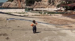 Child alone on disused beach court 2 Stock Footage