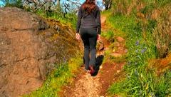 4K Woman Hikes up Rocky Hill Path in Spring Time Stock Footage