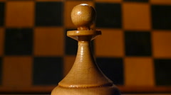 Chess pawn on a background revolves around the board Stock Footage