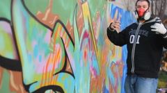 Stock Video Footage of Hip Hop Rap artist Teenager make graffiti on the wall