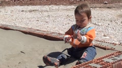 Child plays with sand Stock Footage