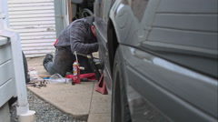 Mechanic Doing A Brake Job On An E39 Bmw 540I Stock Footage