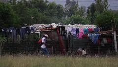 Panoramic wide shot of slum in south african township - stock footage