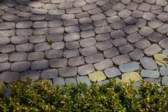 Figured paving slabs Stock Photos